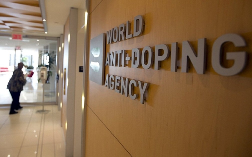 A woman walks into the head office for the World Anti-Doping Agency (WADA) in Montreal, November 9, 2015. An international anti-doping commission recomm