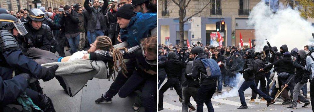 """Polícia francesa deteve 208 manifestantes no centro de Paris após diversos grupos violarem a proibição de manifestações na capital, em vigor desde os atentados terroristas do último dia 13; Marcha pelo Clima, que estava agendada para esta segunda-feira (30), foi cancelada por causa dos atentados que deixaram 130 mortos e 350 feridos; """"Sabemos que existiam elementos perturbadores que nada têm a ver com os ambientalistas"""", disse o presidente francês, François Hollande, ao comentar o episódio"""
