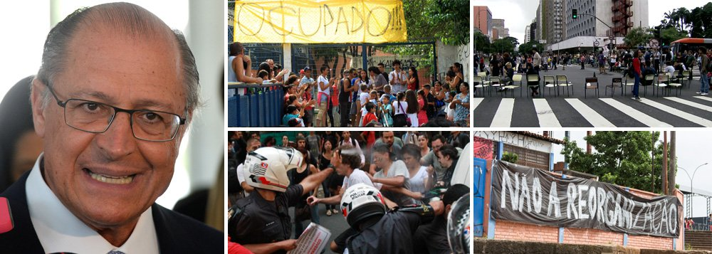 """Secretaria de Educação do Estado de São Paulo anunciou que o decreto sobre a """"reorganização"""" escolar, que prevê fechar 93 unidades, deverá ser publicado nesta terça-feira 1º, apesar da ocupação de nada menos que 204 escolas, segundo a Apeoesp, por estudantes secundaristas até esta segunda-feira, quando os atos completam três semanas; em reunião com dirigentes de ensino na manhã deste domingo, representantes do governo Geraldo Alckmin (PSDB) falaram em organizar """"ações de guerra"""" e """"desmoralizar"""" o movimento, com a ajuda da PM; nesta manhã, um grupo de alunos bloqueou, com carteiras e cartazes, a Avenida Brigadeiro Faria Lima, na zona oeste da capital paulista, por cerca de quatros horas; estudantes dizem querer diálogo, mas Alckmin mantém seu plano sem se perturbar"""