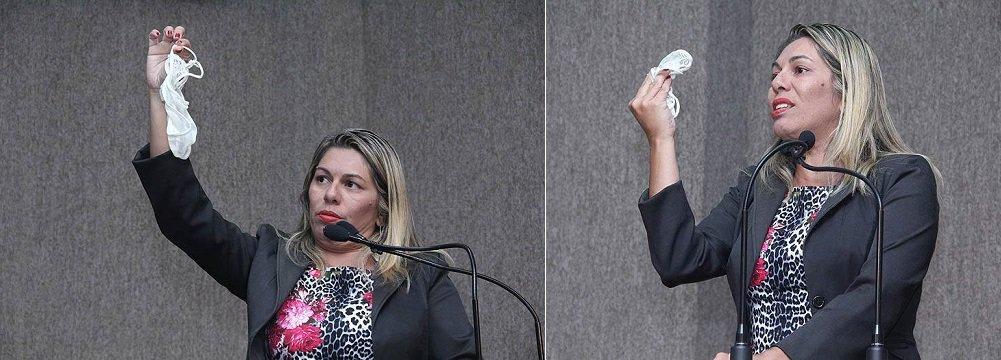 """Vereadora Lucimara Passos (PC do B) surpreendeu o plenário da Câmara de Aracaju, nesta terça (25), ao mostrar uma calcinha, durante discurso em protesto a recentes declarações do também vereador Agamenon Sobral (PP); na semana passada, ao relatar o suposto caso de uma noiva que teria tentado se casar na igreja sem estar usando calcinha, o parlamentar afirmou que a mulher merecia levar uma surra e a chamou de """"vagabunda""""; """"Não é o uso da calcinha que define o caráter da mulher. A mulher não deve ser julgada pela vestimenta e muito menos por uma calcinha que veste, ou não. Trago uma calcinha no bolso e mostro agora aqui na tribuna. Será que serei julgada e condenada a uma surra por isso?"""", questionou ela, erguendo uma calcinha"""