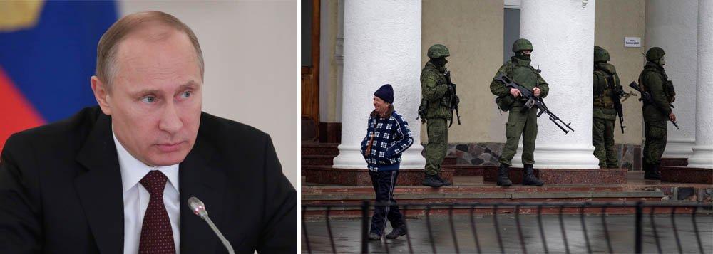 """Tropas russas aparentemente já tomaram a península da Crimeia, rejeitando apelos ocidentais para contenção; primeiro-ministro da Ucrânia, Arseniy Yatseniuk, disse que uma intervenção militar russa levaria à guerra e ao fim de qualquer relação com Moscou; ele pediu uma solução política; o primeiro-ministro daGrã-Bretanha, David Cameron, disse que """"não há desculpa"""" para intervenção"""