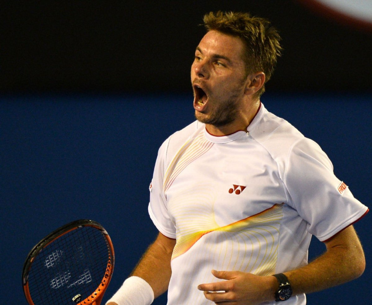IMAGE RESTRICTED TO EDITORIAL USE - STRICTLY NO COMMERCIAL USE Stanislas Wawrinka of Switzerland celebrates beating Tomas Berdych of the Czech Republic in their men's singles match on day 11 of the 2014 Australian Open tennis tournament in Melbourne on Ja