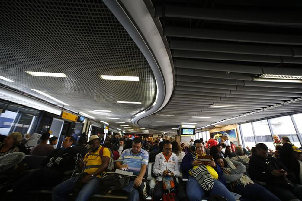 Passengers wait for their delayed flights at Alfonso Pena airport in Curitiba city, June 17, 2014. In a project called 'On The Sidelines' Reuters photographers share pictures showing their own quirky and creative view of the 2014 World Cup in Brazil. REUT