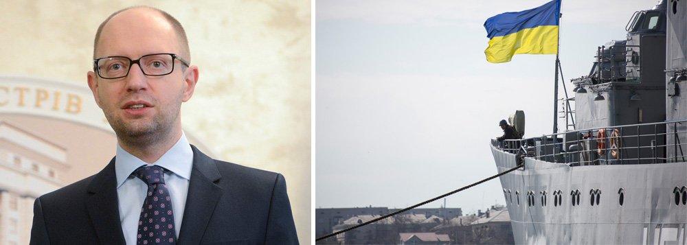 """Morte de militar ucraniano que estava em base atacada na principal cidade da Crimeia, Simferopol, é a primeira resultante da crise na região; primeiro-ministroArseny Yatseniuk denunciou o fato como um """"crime de guerra"""";Ministério da Defesa da Ucrânia informou que seus soldados na Crimeia estão """"autorizados a usar armas"""""""
