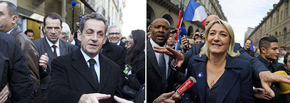 """Partido conservador UMP, do ex-presidente francês Nicolas Sarkozy, e seus aliados lideram o segundo e decisivo turno das eleições locais na França neste domingo, apontou pesquisa de boca de urna realizada pelo instituto CSA e divulgada pela BFMTV ; Frente Nacional, de extrema direita e liderada por Marine Le Pen, caminha para conquistar terreno e pode ficar com dois conselhos de """"departamentos"""" franceses"""