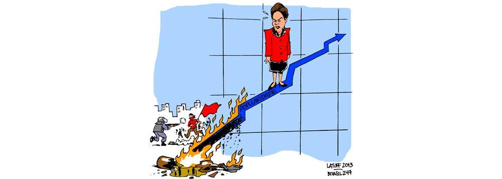 Latuff: os protestos e a popularidade de Dilma