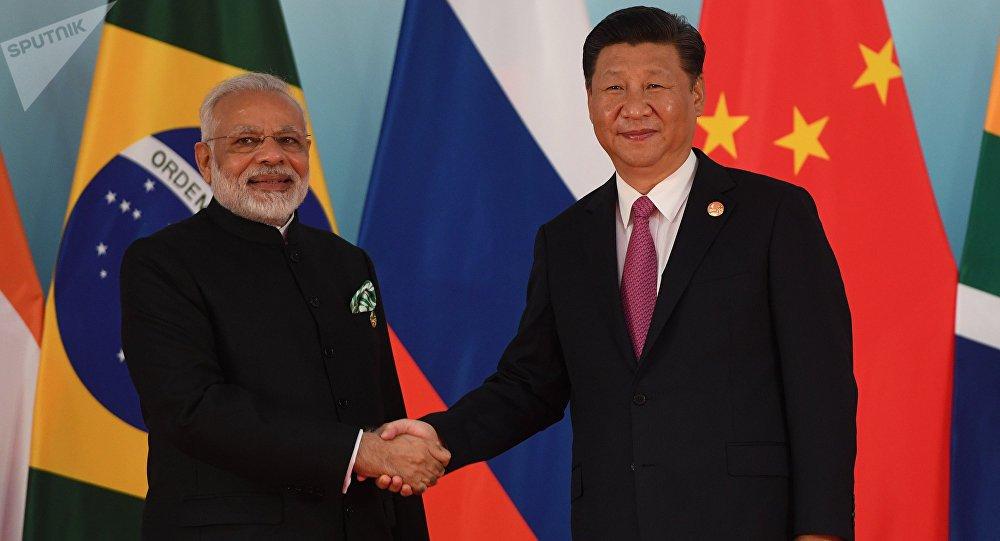 China pede que Índia se una a esforços para conter perseguição dos EUA