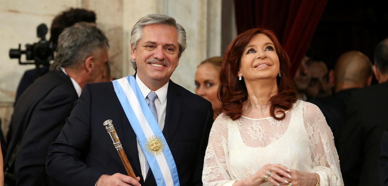 Argentina's President Alberto Fernandez holds the symbolic leader's staff, next to new Vice President Cristina Fernandez de Kirchner, after he was sworn in as Argentina's next president, in Buenos Aires, Argentina December 10, 2019. REUTERS/Agustin Marcarian