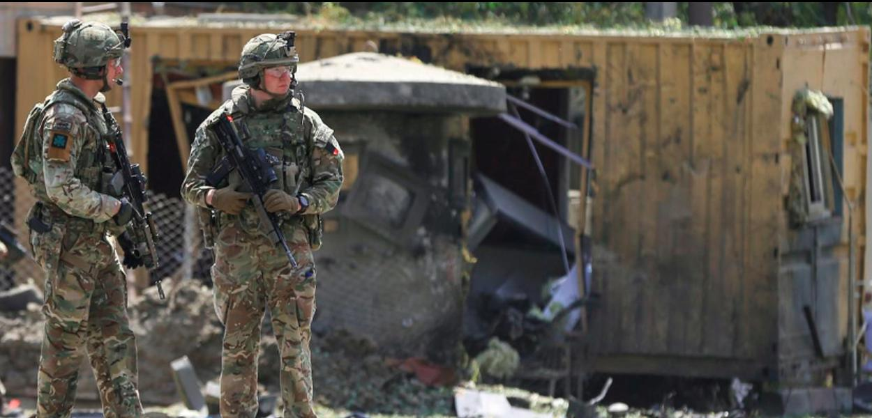 Foreign troops with NATO-led Resolute Support Mission investigate at the site of a suicide attack in Kabul, Afghanistan September 5, 2019