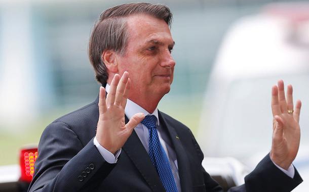 Brazil's President Jair Bolsonaro gestures as he leaves the Alvorada Palace in Brasilia, Brazil December 12, 2019. REUTERS/Adriano Machado