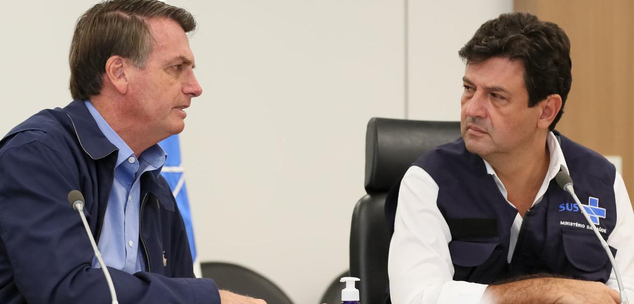 Jair Bolsonaro e o Ministro da Saúde, Luiz Henrique Mandetta,  durante Videoconferência com a Frente Nacional de Prefeitos - FNP.
