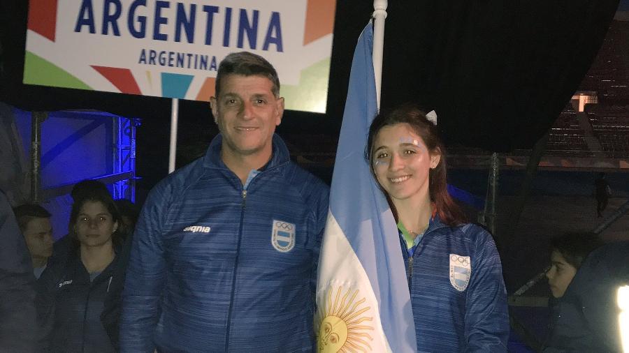Diego Gusmán e a nadadora Delfina Pignatiello