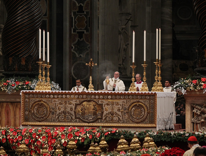 Pope Francis celebrates Midnight Mass in St. Peter's Basilica in 2015.
