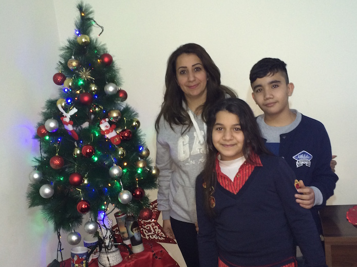 Suha, a Syriac Catholic uprooted from Qaraqosh, Iraq, by the Islamic State in August 2014 with two of her three children. The family is living in exile in Beirut, Lebanon.