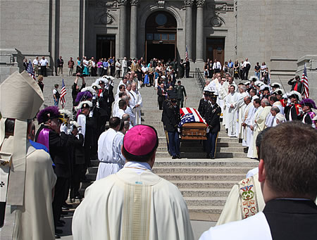 Father Timothy Vakoc's casket is carried from St. Paul Cathedral, June 26, 2009.