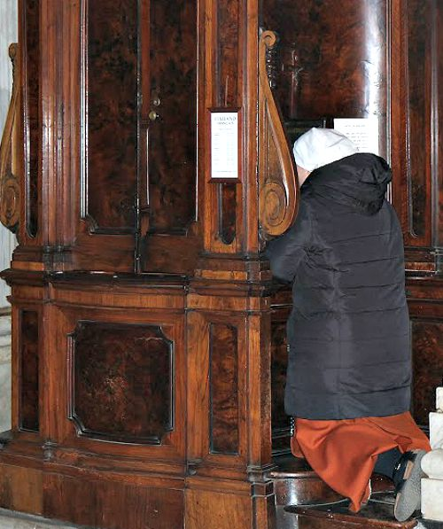 A woman goes to confession at the Basilica of St. Mary Major`s during the during the Vigil for Life in March.