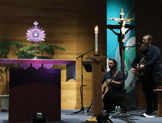 Lee Roessler and Dave Moore play music during adoration Sept. 26 in Rochester, N.Y.