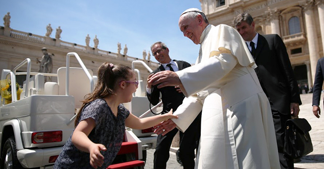 Pope Francis reaches out to greet Grazia, a girl with Down syndrome, during the Wednesday General Audience in St. Peter's Square on May 13, 2015, the feast day of Our Lady of Fatima.