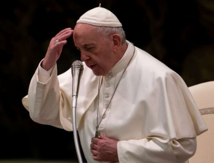 Pope Francis makes the sign of the cross during his Angelus address, 2019.