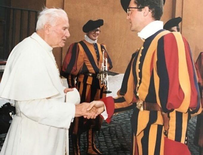 Pope John Paul II shakes the hand of Swiss guard, Mario Enzler, 1990.