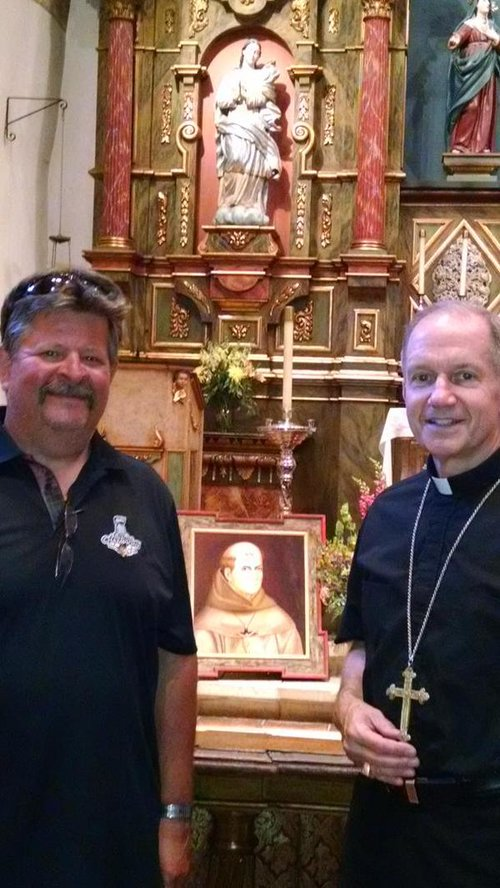 Bishop Paprocki with his cousin Mike Gray at the tomb of Blessed Junipero Serra in Carmel, Calif., where the bishop celebrated Mass.