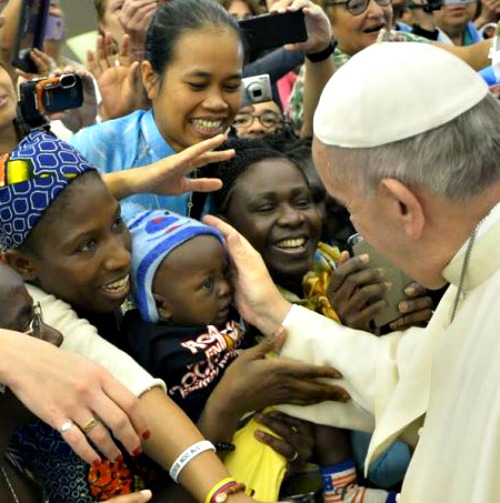 Pope Francis greets pilgrims before his general audience in the Paul VI Hall on Aug. 19.