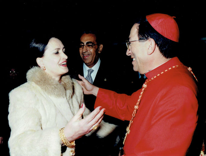 Martha Alegria Reichmann congratulates Cardinal Oscar Maradiaga Rodriguez upon his elevation to cardinal.
