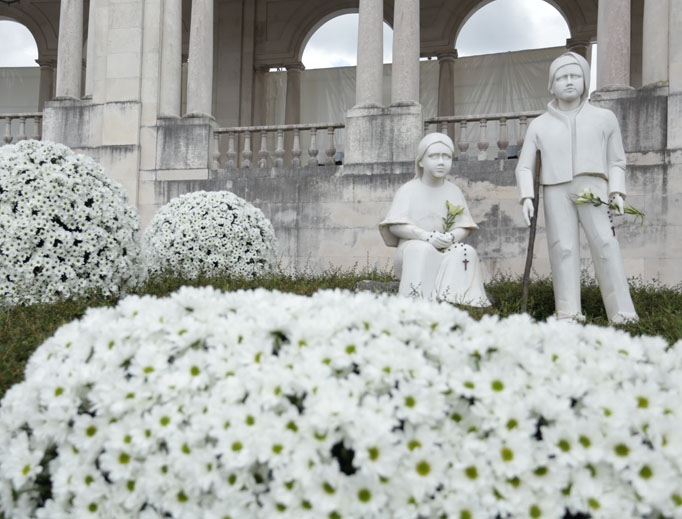 STS. FRANCISCO AND JACINTA. Statues of the new saints remind pilgrims of their holiness.