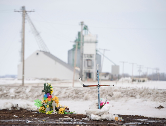 A cross made out of hockey sticks is seen at the intersection of a fatal bus crash near Tisdale, Saskatchewan, April 9.