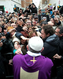 Pope Francis greets people after celebrating Mass at St. Anne's parish on March 17.