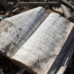 APPROPRIATE. A hymnal discovered amid the ruins of the tornado that hit OOO was left open, eerily, to a hymn that read, in part, 'And we'll sing glory; we'll shout when we're caught up to meet him in the air.'