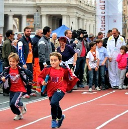 Children run during a Vatican sports event on Oct. 20.