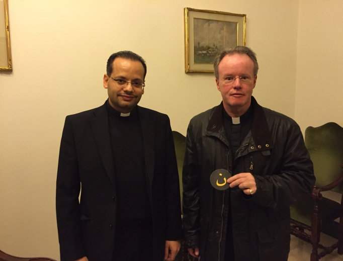 Father Benedict Kiely (r) meets in Rome with Pope Francis' private secretary, Msgr. Yoannis Lahzi Gaid, a Coptic Catholic priest from Egypt.