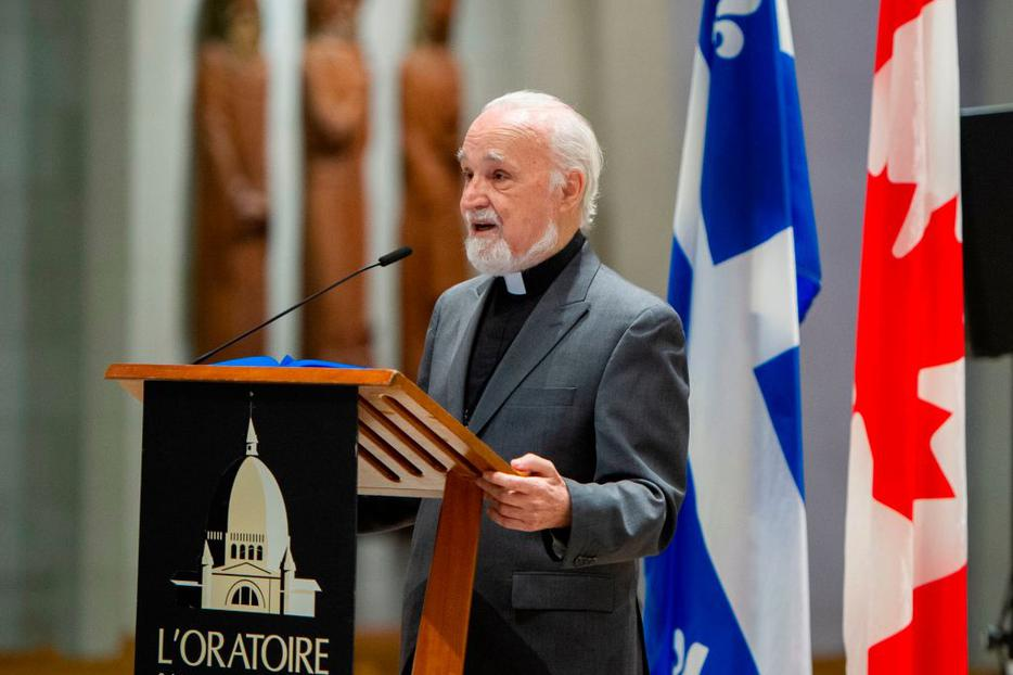 Father Claude Grou, shown speaking at a March 1 news conference about the work to be done at St. Joseph's Oratory in Montreal, was stabbed during a livestreamed morning Mass at the oratory. He has been released from the hospital.