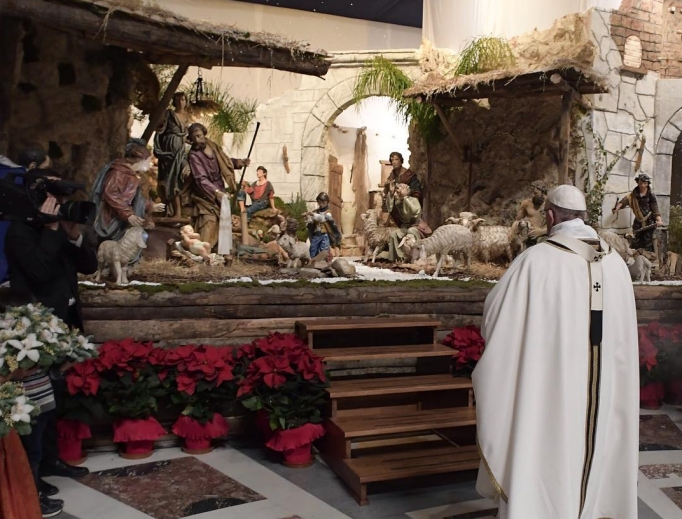 Pope Francis contemplates the Vatican Nativity scene.