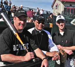 The DC Padres team is made up of priests and seminarians. Father Larry Young (team manager), Bishop Martin Holley and Ken Sheiber (announcer).