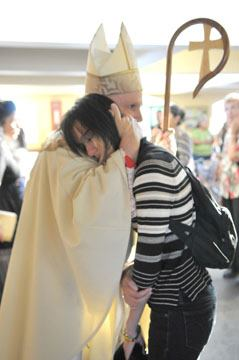 Archbishop Aquila was ready to comfort mourners at July 20 Mass for the victims.
