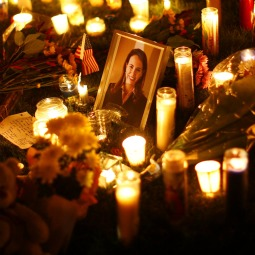 VIGIL. A picture of U.S. Rep. Gabrielle Giffords, D-Ariz., is surrounded by candles during a vigil outside the Tucson University Medical Center in Arizona Jan. 9. Giffords was in critical condition at the medical center after being shot in the head by Jared Lee Loughner, 22. He is accused of killing six people and wounding 14 others in the Jan. 8 shooting rampage.