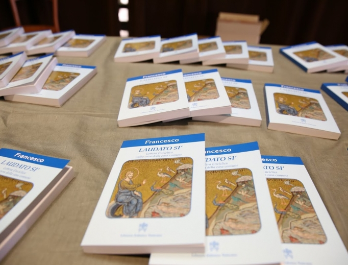 Copies of Laudato Si are displayed at a news conference in Paul VI Hall on June 18, 2015.