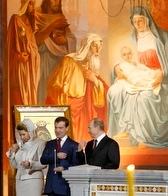 President Medvedev, center, his wife, Svetlana, and Prime Minister Putin.