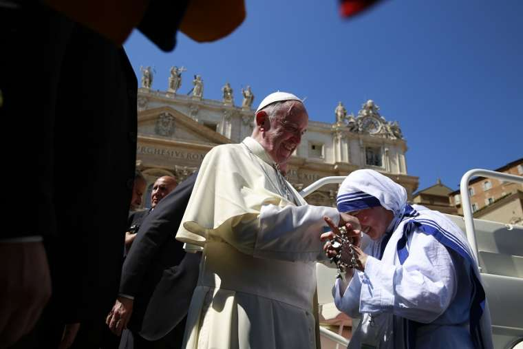 Pope Francis meets a Missionary of Charity at the canonization Mass of Mother Teresa Sept. 4, 2016.