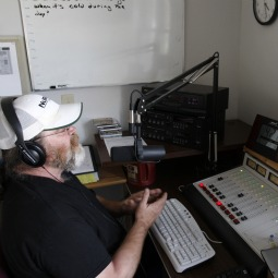Jeff Abbas, manager of KPVL-FM radio station in Postville, Iowa, is pictured during a live broadcast in 2009 in the studio. Catholic and other religious organizations hope low-power stations like KPVL will grow in number.