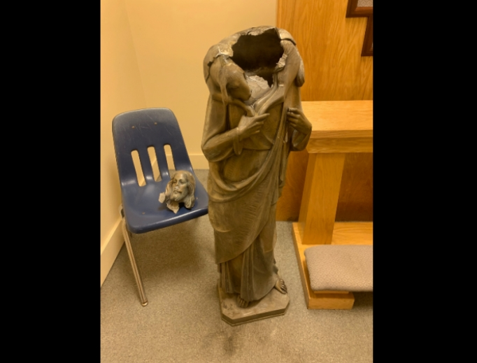 Statue of Christ the Good Shepherd after attack Tuesday night.