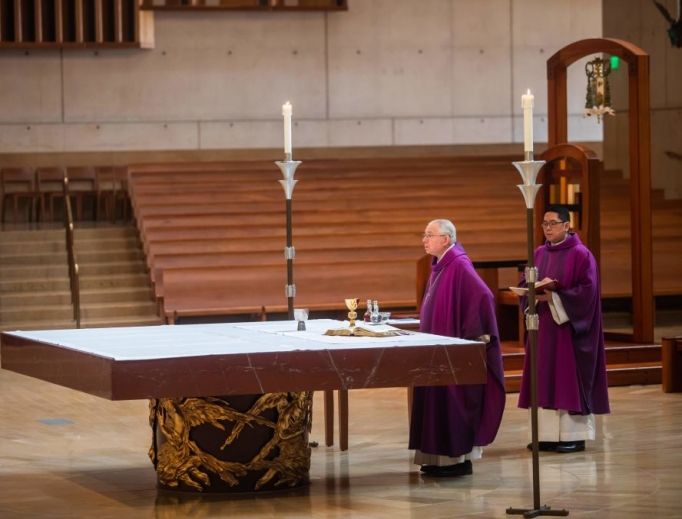 Archbishop José Gomez leads an online Sunday Mass at the Cathedral of Our Lady of the Angels, as the church was closed to the public, on March 22 in Los Angeles. Millions are adjusting to life in various phases of lockdown across the United States.