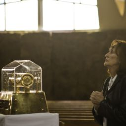 Joyce Gould prays in front of the relic of St. Mary Magdalene Feb. 15 that visited Holy Rosary Church in Antioch, Calif. Seventh-graders from the parish school attended the service.
