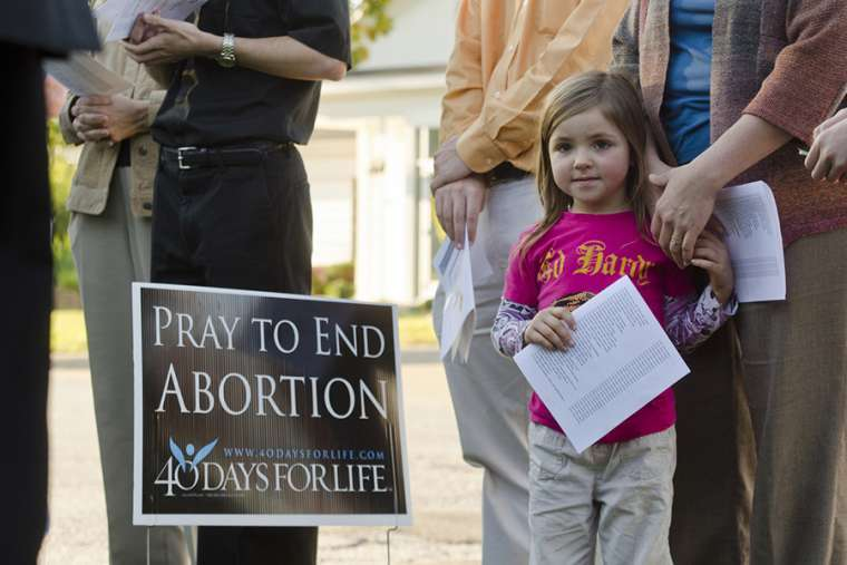 Pro-lifers pray outside of an abortion business.