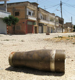 A shell lays in the middle of the street in Homs, Syria, a remnant of the heavy attack leveled on the city on June 11, 2012.