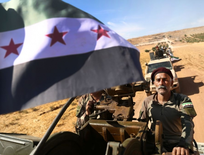 Turkish-backed Syrian rebel fighters head to an area near the Syrian-Turkish border north of Aleppo on Oct. 8. U.S. forces in northern Syria started pulling back from areas along the Turkish border ahead of the Turkish invasion.