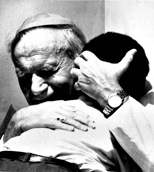 Pope John Paul II hugs a young Mauritius child on Oct. 16, 1989, during his visit to Mauritius.