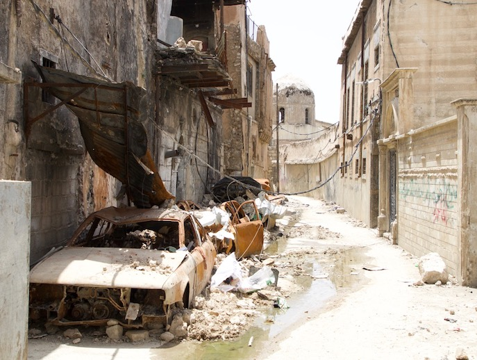 Wrecked cars line a bombed-out street in the Old City of Mosul, Iraq, May 26. Almost none of the 3,000 Iraqi Christian families that lived in the city before it was occupied by ISIS have returned since it was liberated.